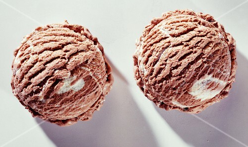 Two scoops of chocolate and vanilla ice cream