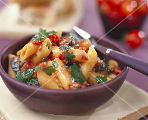 Penne with tomato and caper sauce and parsley