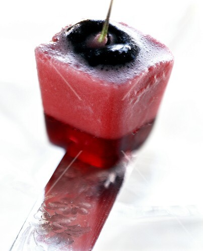Cherry in cube of cherry jelly and cherry yoghurt mousse
