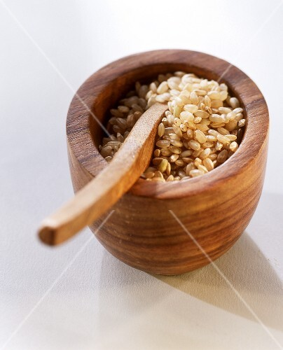 Brown short-grain rice in a wooden bowl