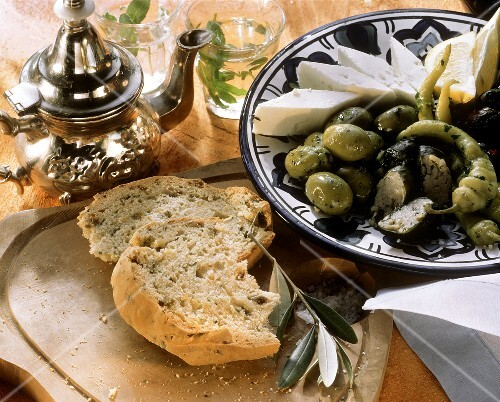 Plate of mixed appetisers, olive bread and tea