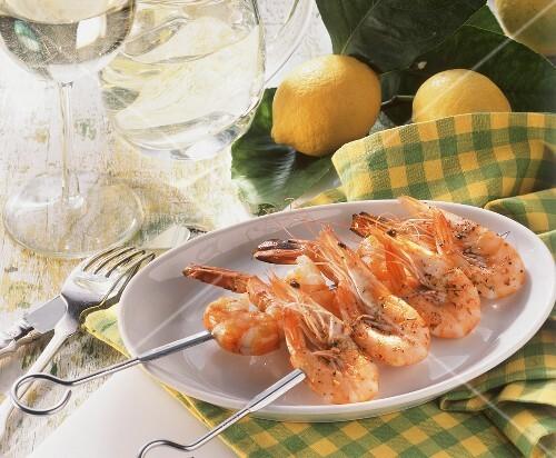 Skewered shrimps on a plate