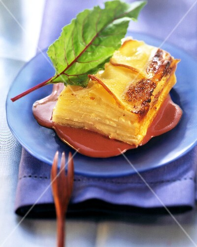 Potato and cheese lasagne on beetroot whip