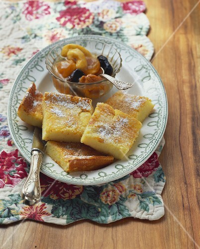 Semolina slices with dried fruit compote