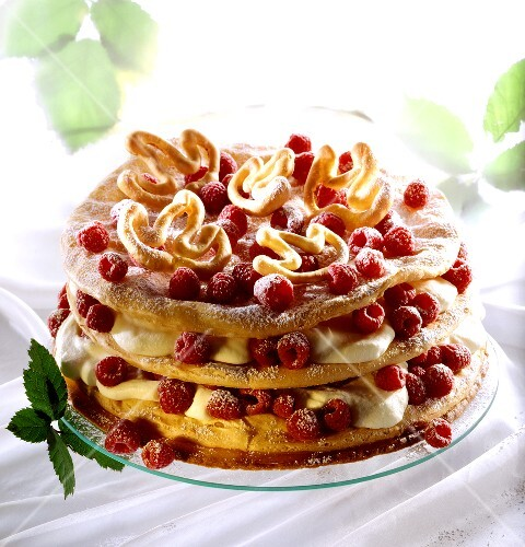 Choux pastry cake with cream and raspberries