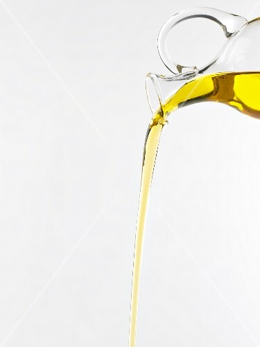 Pouring olive oil from carafe