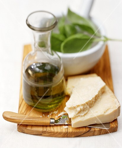 Still life with Parmesan, olive oil and fresh basil