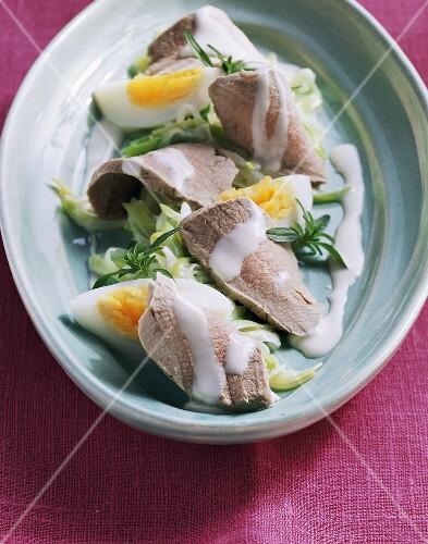 Pork fillet on leek salad with boiled eggs