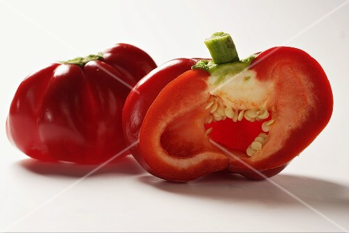 Two peppers, one halved
