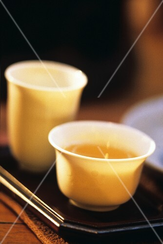 Chinese tea ceremony Gong Fu Cha: half-fermented tea in bowl, aroma cup behind