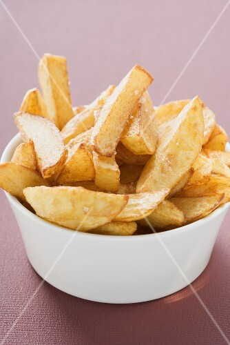 Potato wedges in white bowl