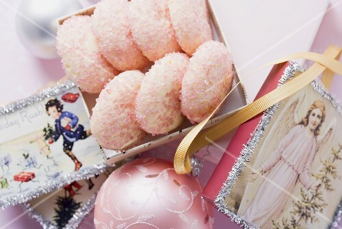 Pink sugar cookies surrounded by Christmas decorations