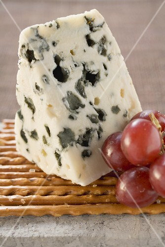 Blue cheese with grapes and salted sticks