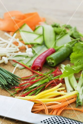 Assorted vegetables cut into strips, herbs and mushrooms