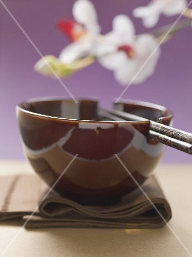 Asian place-setting (napkin, bowl and chopsticks)