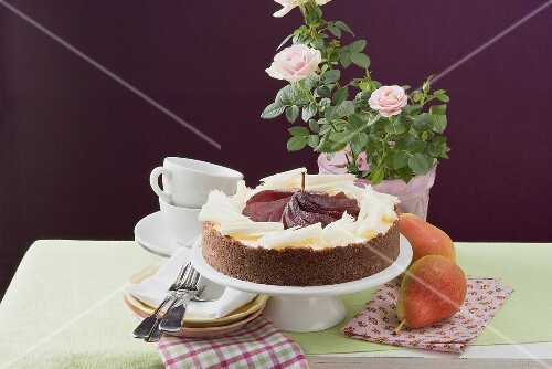 Cheesecake with red wine pears and white chocolate curls