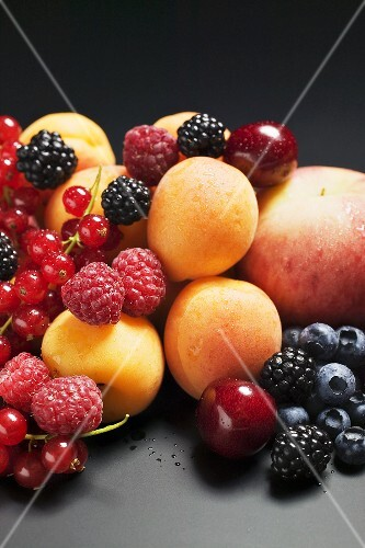 Fruit still life with stone-fruit and berries