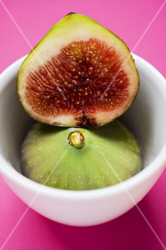 Whole and half fig in bowl