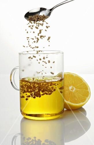 Dissolving lemon tea (instant) in a glass