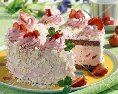 Strawberry ice cream cake, a piece taken