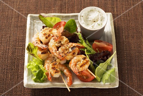 Mixed salad with prawn skewers