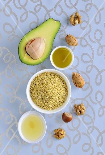 Healthy vegetable fats: nuts, avocado, millet, oil