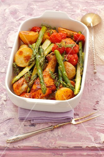 Chicken drumsticks with new potatoes, green asparagus & cherry tomatoes
