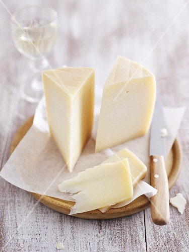 Pieces of Pecorino cheese on wooden board
