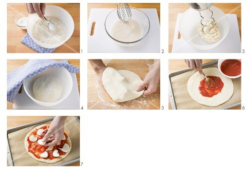 Making pizza topped with tomato sauce and mozzarella