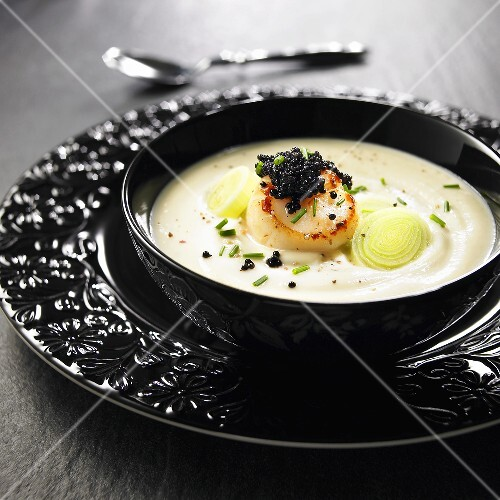 Cauliflower soup with scallop, black caviar and leek