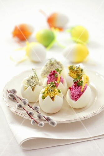 Eggs stuffed with coloured cream cheese for Easter