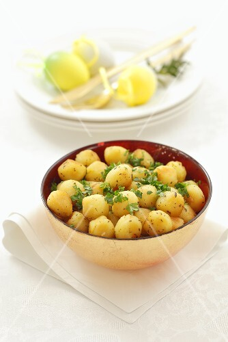 Deep-fried potato balls with parsley for Easter
