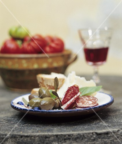 Italian snack with hard cured sausage, olives and cheese