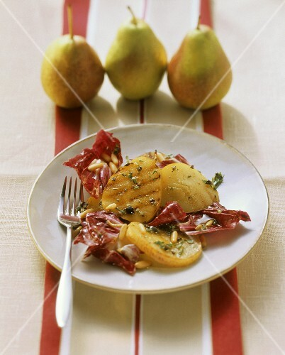 Marinated grilled pears with radicchio and pine nuts