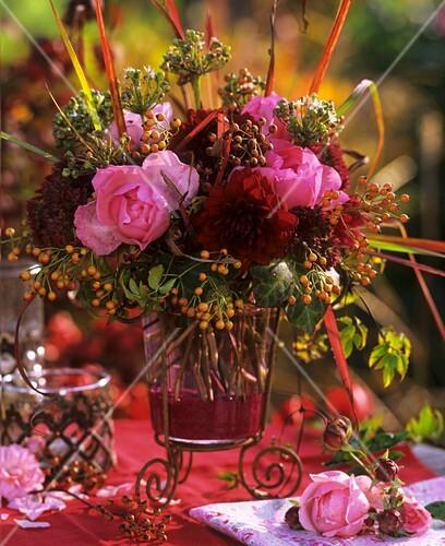 Arrangement of roses, dahlias, stonecrop, ornamental onions, ivy