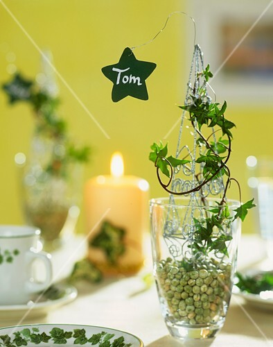 Place-card on decorated glass filled with peas