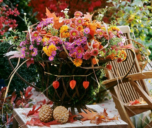 Moss-lined iron basket with florist's foam