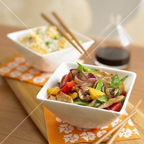 Fried pork with vegetables, rice, Hoisin sauce (China)