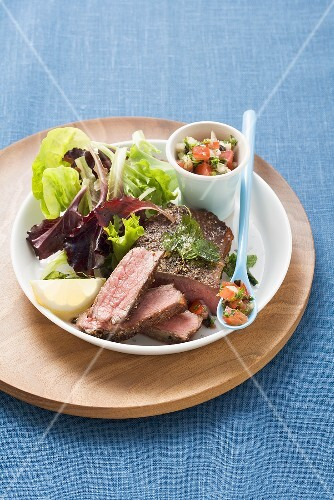 Rump steak with tomato and olive salsa