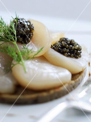 Scallop carpaccio with black caviar