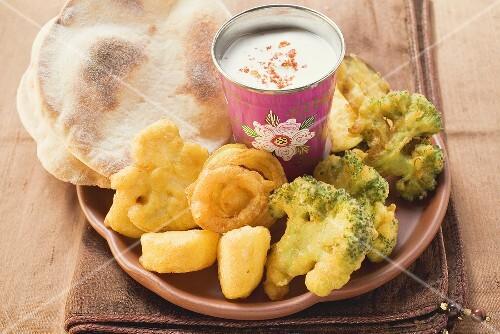 Vegetable tempura with yoghurt dip and Indian flatbread