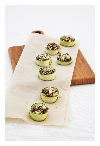 Courgette rolls with wild rice and nut filling