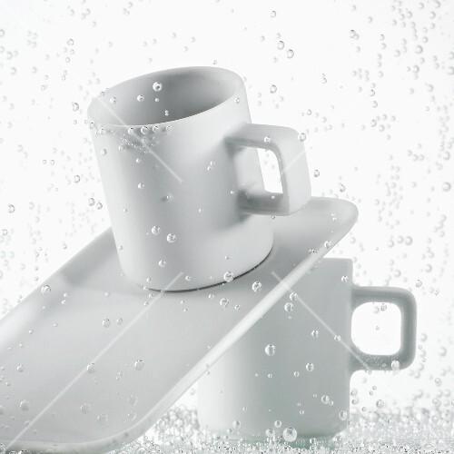 Espresso cups in water