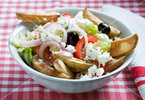 Greek salad with potato wedges