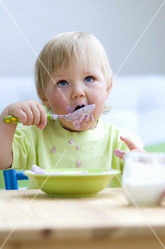 Toddler eating baby food