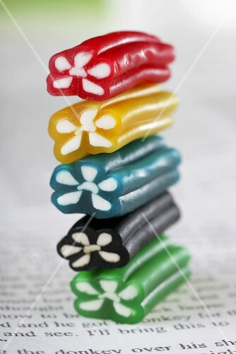 A stack of colourful sweets on a book
