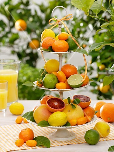Assorted citrus fruit on tiered stand