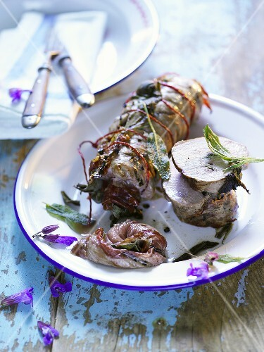 Barbecued pork fillet wrapped in bacon and sage