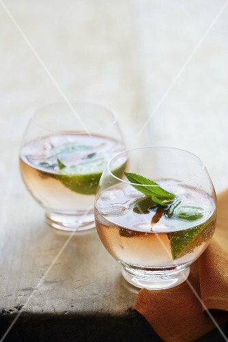 Pink gin (Gin and bitters) with mint