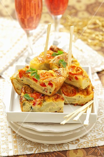 Potato tortilla with peppers and tomatoes